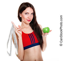 Young slim woman with measuring tape and apple