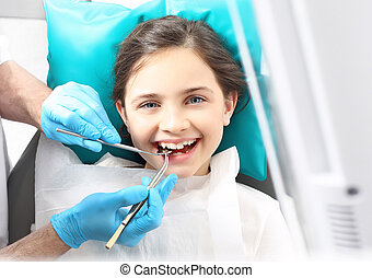Child to the dentist - Child in the dental chair dental...