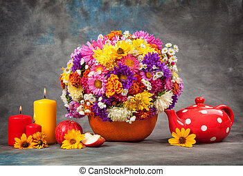 Autumn still life. flowers and candles.