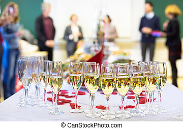 Banquet event Waiter pouring champagne into glass Table with...