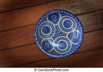 Porcelain plate on a wooden table