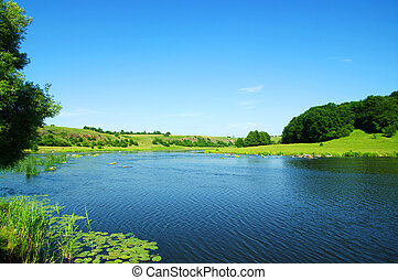 river in summer - river and blue sky in summer