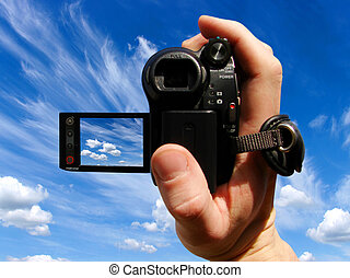 video camera - a man takes off sky a video camera