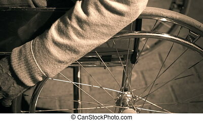 Manual Wheelchair - Sepia close up of cropped disabled...