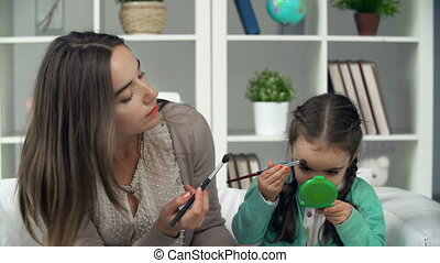 Beautycare - Close up of mother playing with her daughter...
