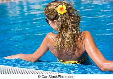 Blonde girl in swimming pool - Beautiful blonde long-haired...