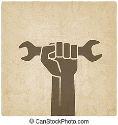 worker hand with wrench symbol old background - vector...