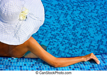 Woman with white hat in swimming pool - Woman with white hat...