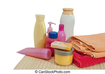 Toiletries with pink towel - Toiletries and soap on pink...