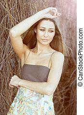 Fashion model - Beautiful fashion model posing outdoor in...