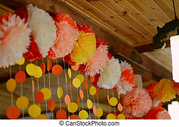 floral paper garland - hut of wooden frame with festive...