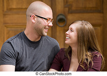 Happy Young Couple Laughing