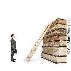 Businessman standing near stack of books and ladder on white