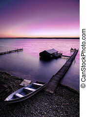 Lake Sunrise - A beautiful autumn sunrise on the pebbled...