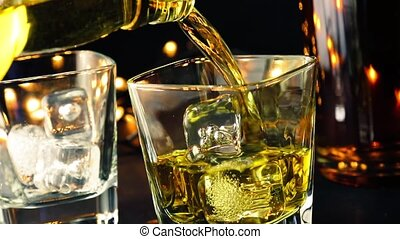 whiskey on bar table near bottles - barman pouring whiskey...