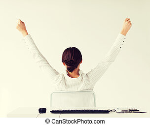 woman from the back with raised hands - business, office,...