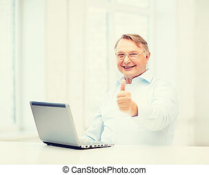 old man with laptop computer showing thumbs up - technology,...
