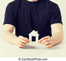 man hands holding paper house - picture of man hands holding...