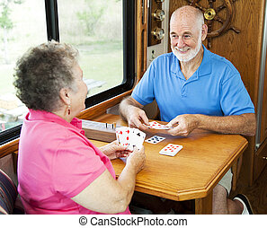 RV Seniors - Card Game - Senior couple vacationing in their...