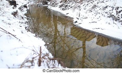 Houses reflecting in a stream - Running streams of clean ice...