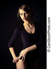 black color - Slender woman in black fitting body over black...