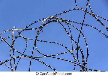 barbed wire - a site is protected with barbed wire
