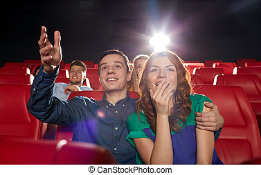happy friends watching movie in theater - cinema,...