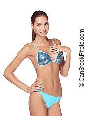 Slim tanned woman in blue bikini
