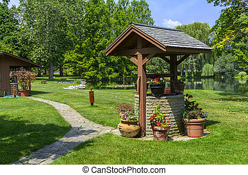 Wishing Well - Beautiful photo of a wishing well in a garden...