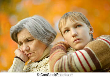 Grandmother with boy - Sad Grandmother with boy in the...