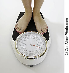 Womans feet on scales