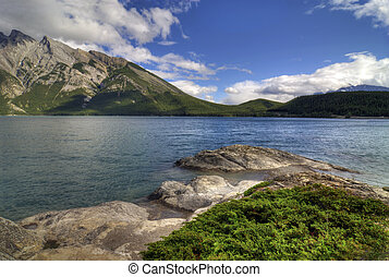 Lake Minnewanka in Banff Natinoal Park Canada. Surrounded by...