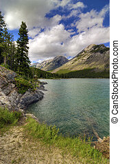 Lake Minnewanka in Banff Natinoal Park Canada Surrounded by...