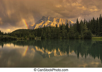 Mount Rundle Sunset Rainbow - A rainbow over Mount Rundle at...