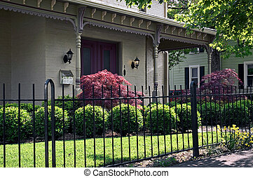 Home Entrance - Wrought iron fencing and ornate Victorian...