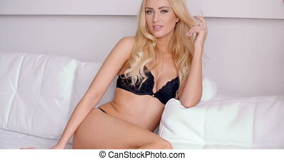 Sexy Woman in Black Undies Sitting on White Couch