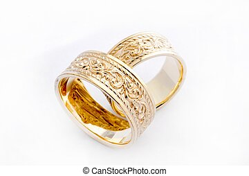 Wedding Rings - Pair of handcrafted gold wedding rings on...