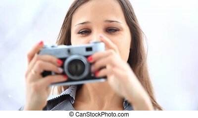 young woman photographer with vintage film camera HD...