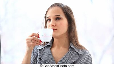 Young businesswoman drinking a cup of tea speaking mobile smart phone. HD. 1920x1080. Close up