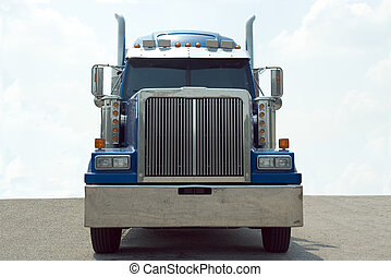 Semi Truck - Front view of a blue 18 wheel semi truck with a...