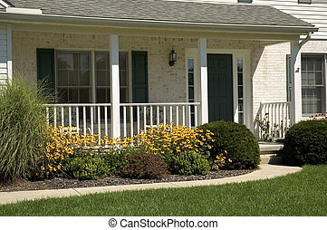Home - Front porch and entrance of a nice white brick home
