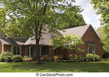 House 36 - Beautiful house with mature trees framing it.