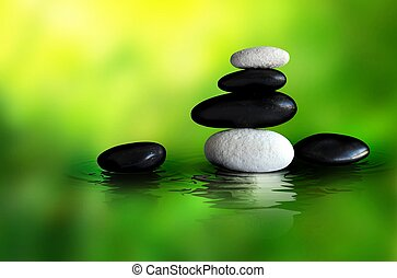 Spa Stones on a green blured background