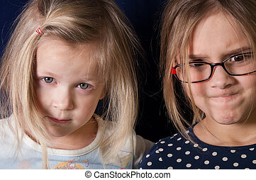 Angry Girls - Two girls with suspicious gaze, horizontal...
