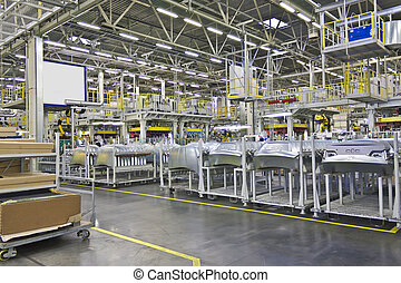 machine - body parts in a warehouse in a factory to assemble...