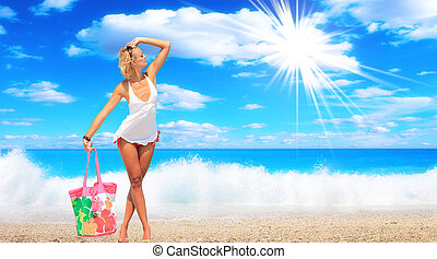 woman relaxing in the afternoon by the sea
