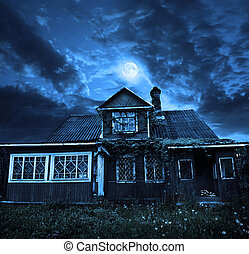 moon in a cloudy sky, above the old wooden house
