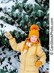 Five years girl near snow-covered fir tree - Five year girl...