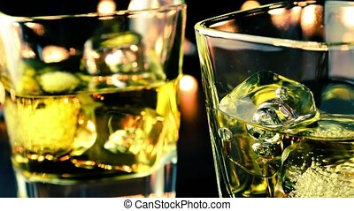 whiskey on bar table and take these - barman pouring whiskey...