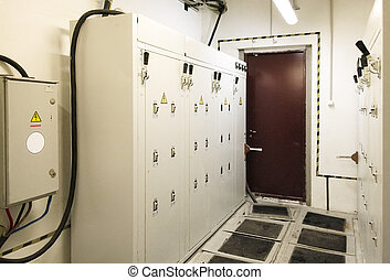 switchboard cabinets with metal, rubber mats on the floor...